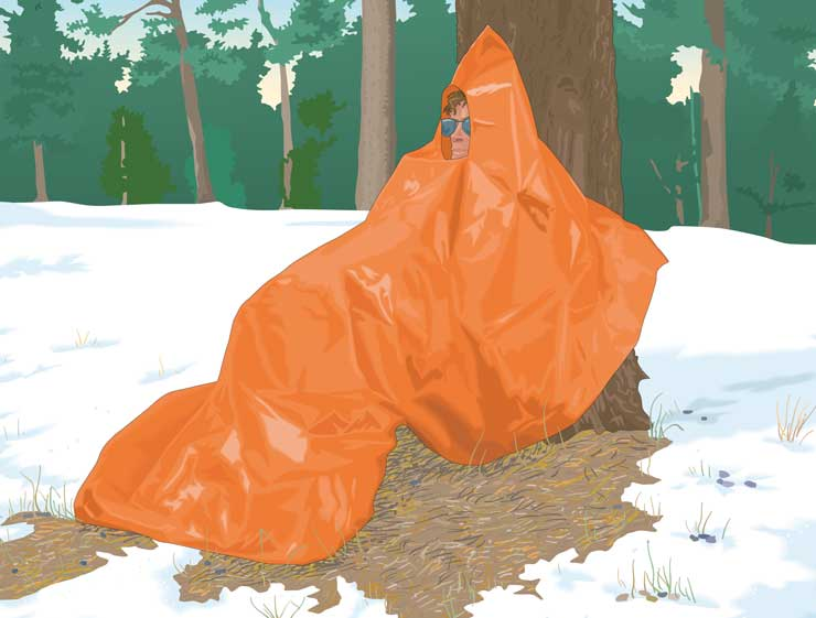 Outdoorsman wrapped in a thermal foil blanket to prevent hypothermia