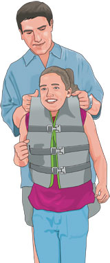 Adult checking size of PFD on young girl