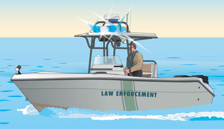 Law enforcement officer standing in a law enforcement vessel