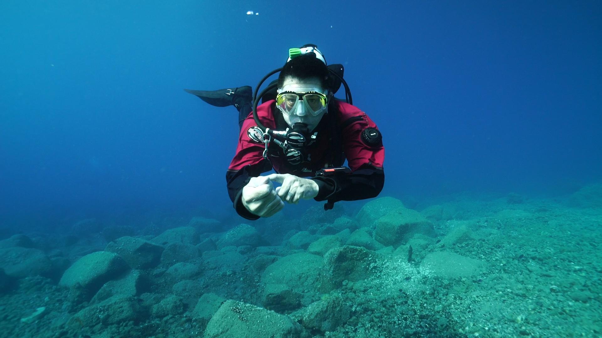 Scuba diver checking the gauge