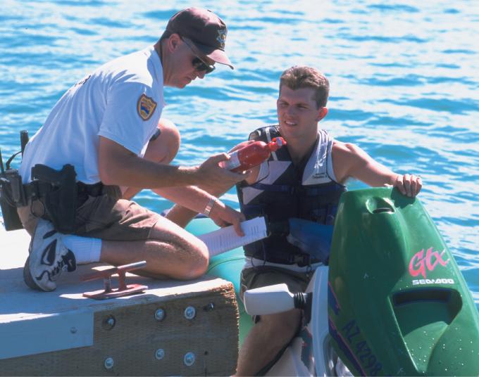 Enforcement Officer Inspecting Fire Extinguisher