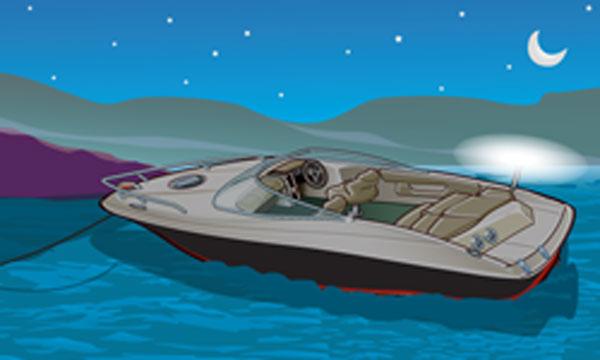 Anchored boat at night