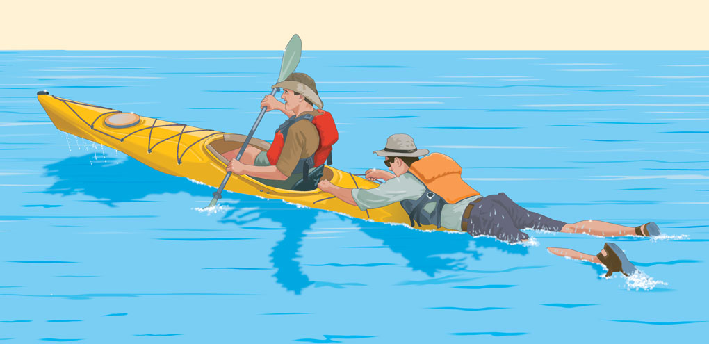 Towing a swimmer with a kayak rescue technique