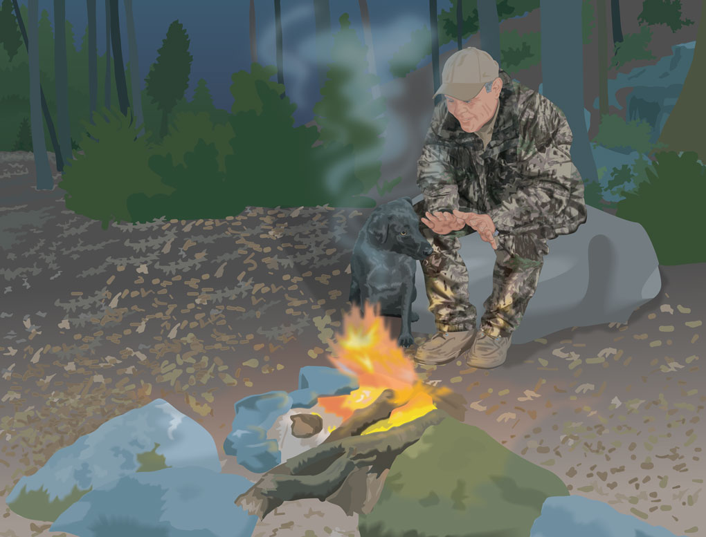 Hunter sitting near campfire, warming himself