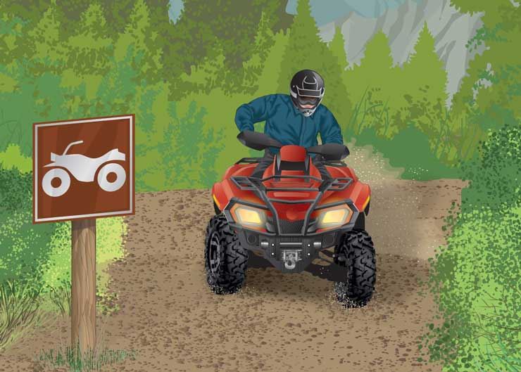 ATV driver traveling on an ATV trail