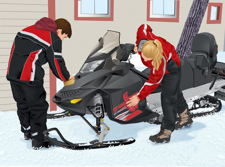 Snowmobilers cleaning the snowmobile