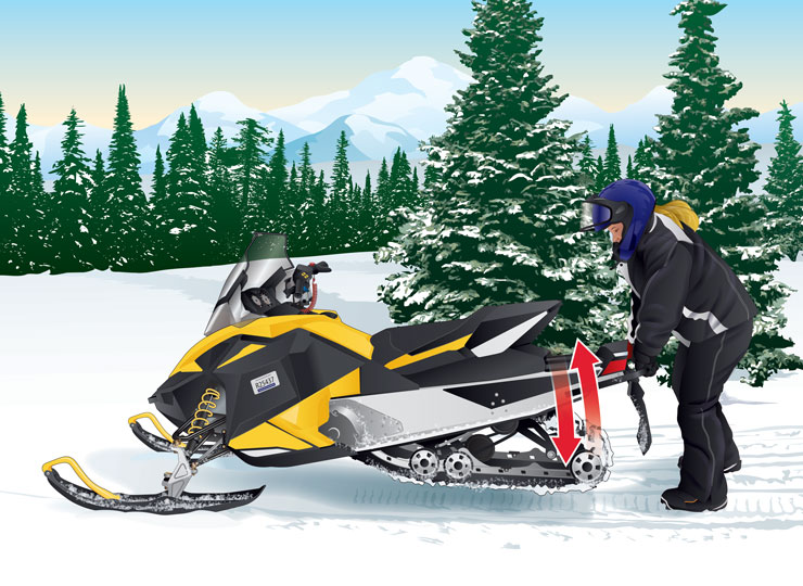 Snowmobiler freeing snowmobile's frozen track