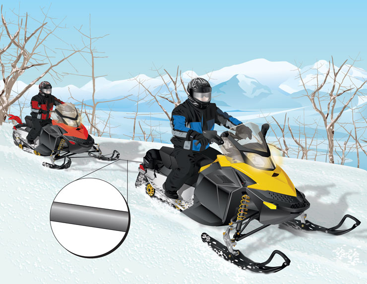 Snowmobilers towing a disabled snowmobile