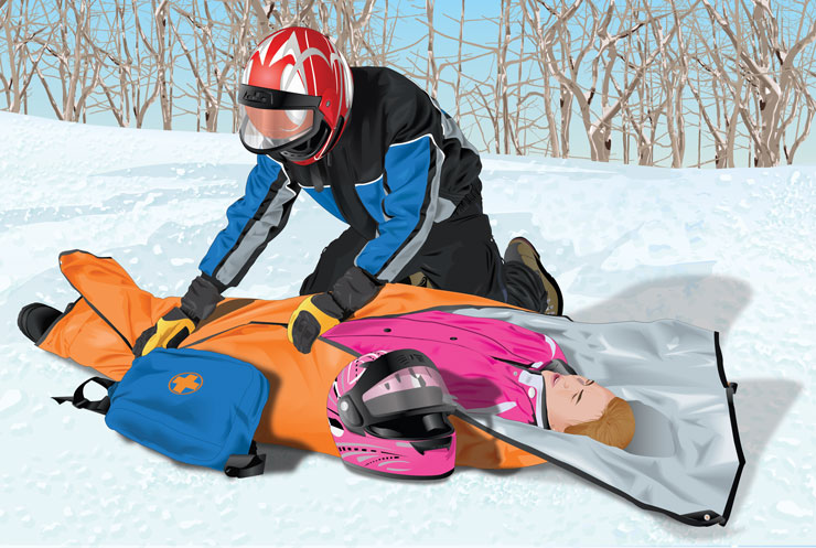 Injured rider being assisted by another snowmobiler