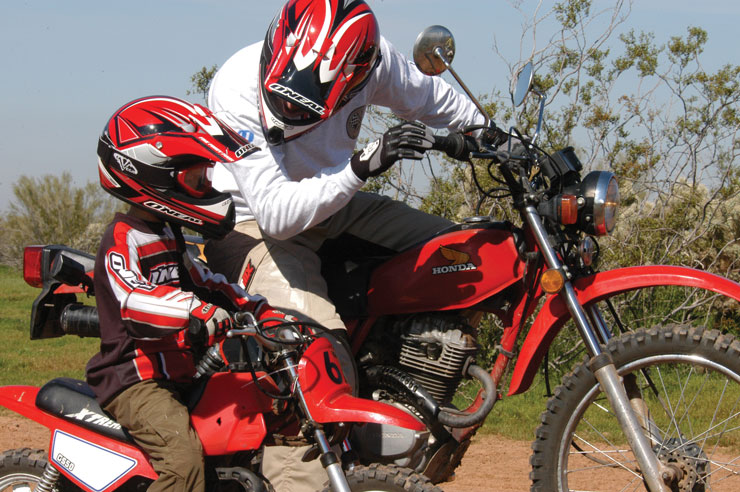 Father and son on dirt bikes