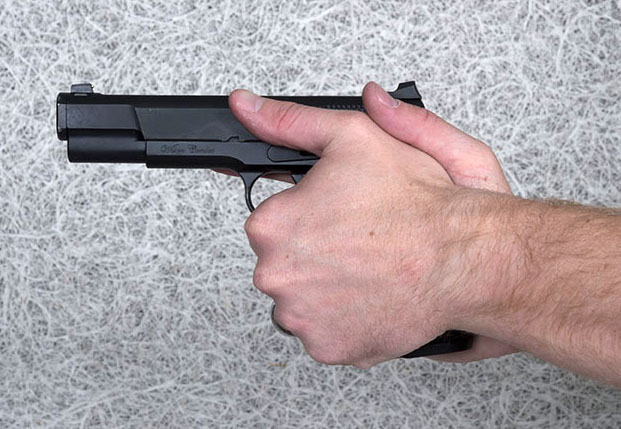Two-handed handgun grip