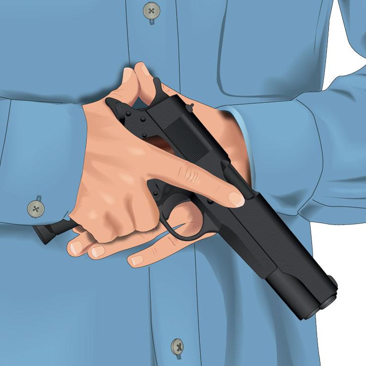 Handgun pointed in safe direction
