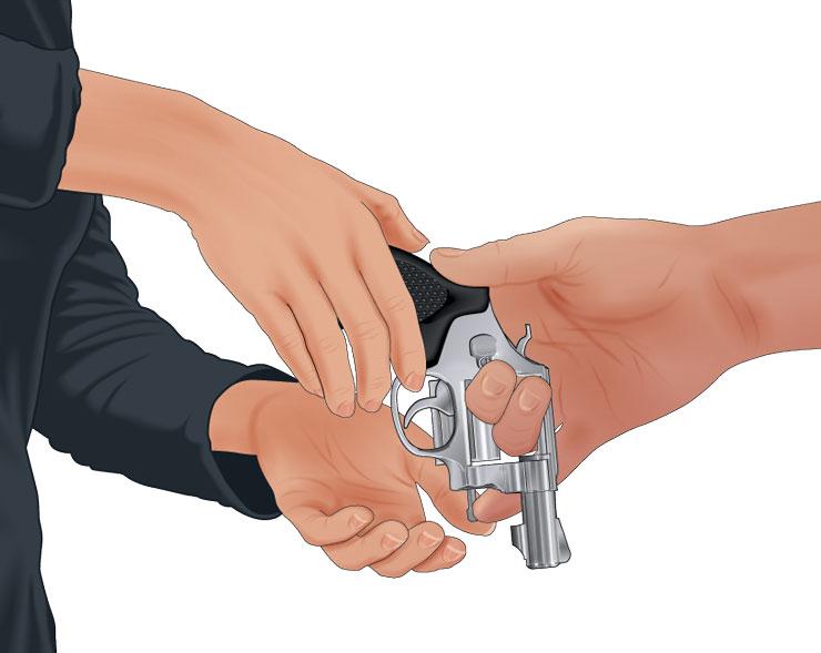 Handling a handgun safely