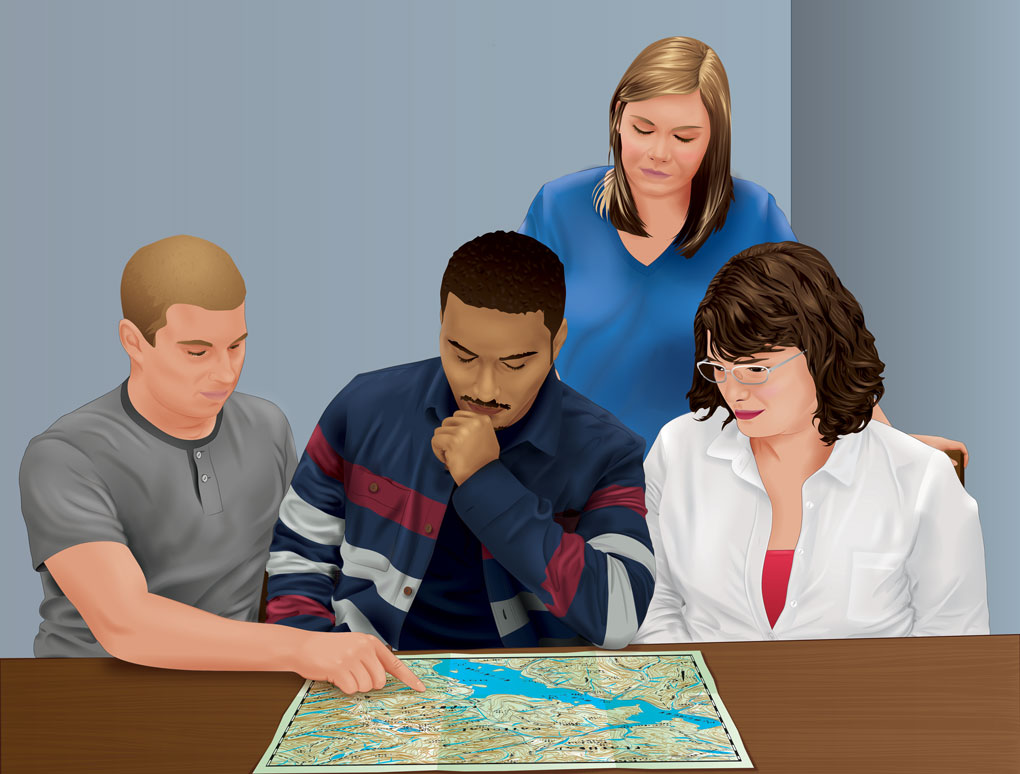 Four people looking at a map