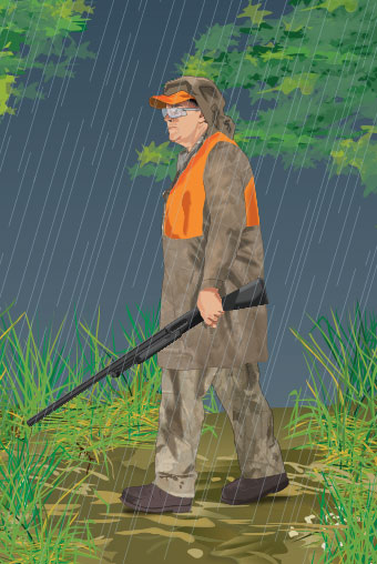 Hunter wearing rain gear
